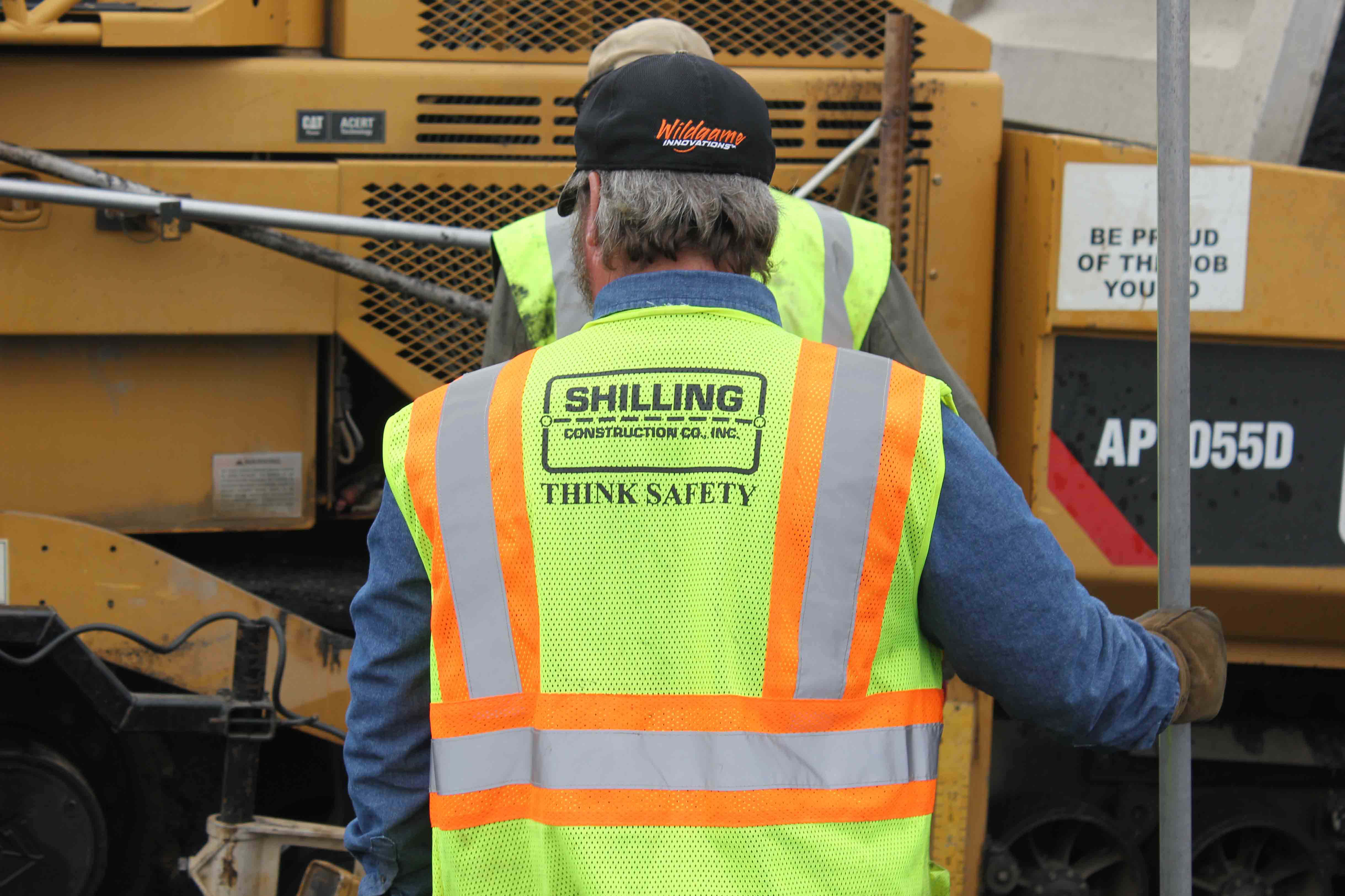 Shilling worker in his vest