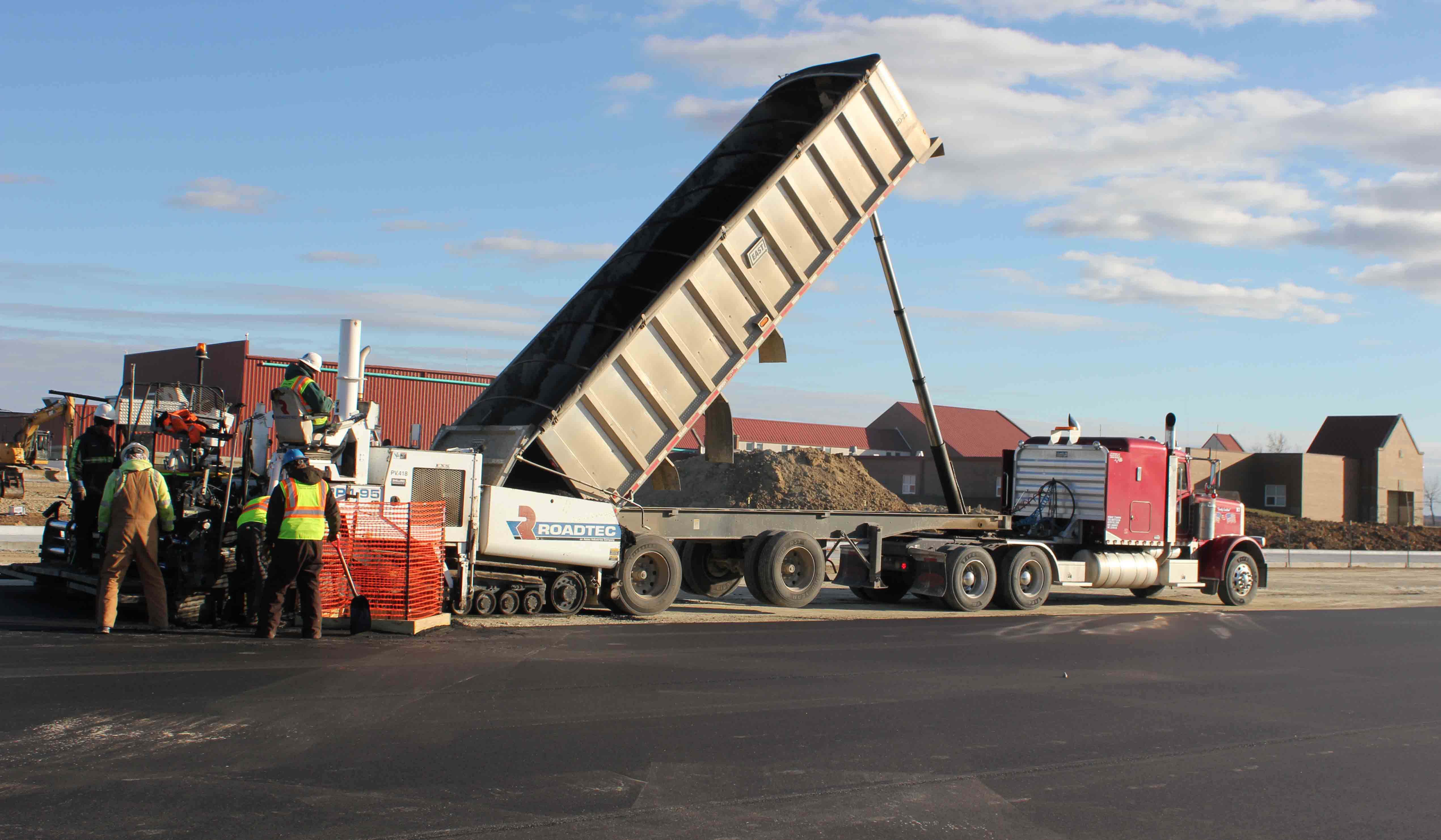 Shilling truck dumping asphalt materials